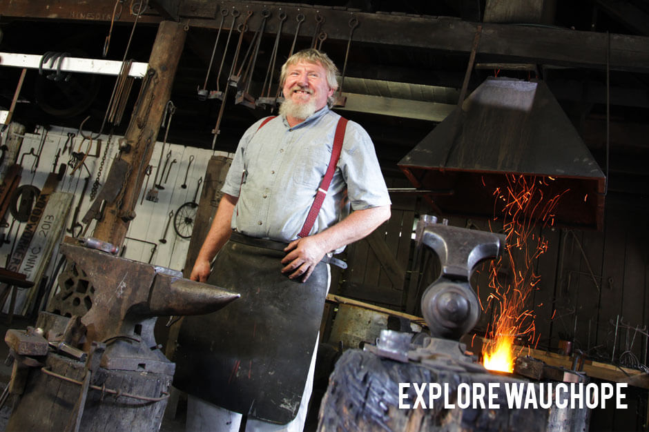 Explore-Timbertown-Doug-in-the-Smithy.jpg